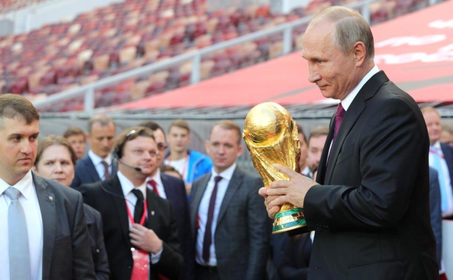 Russian+president+Vladimir+Putin+holds+the+FIFA+World+Cup+Trophy+at+a+pre-tournament+ceremony+in+Moscow+in+September+2017.+%28Photo+via+Wikimedia+Commons%29