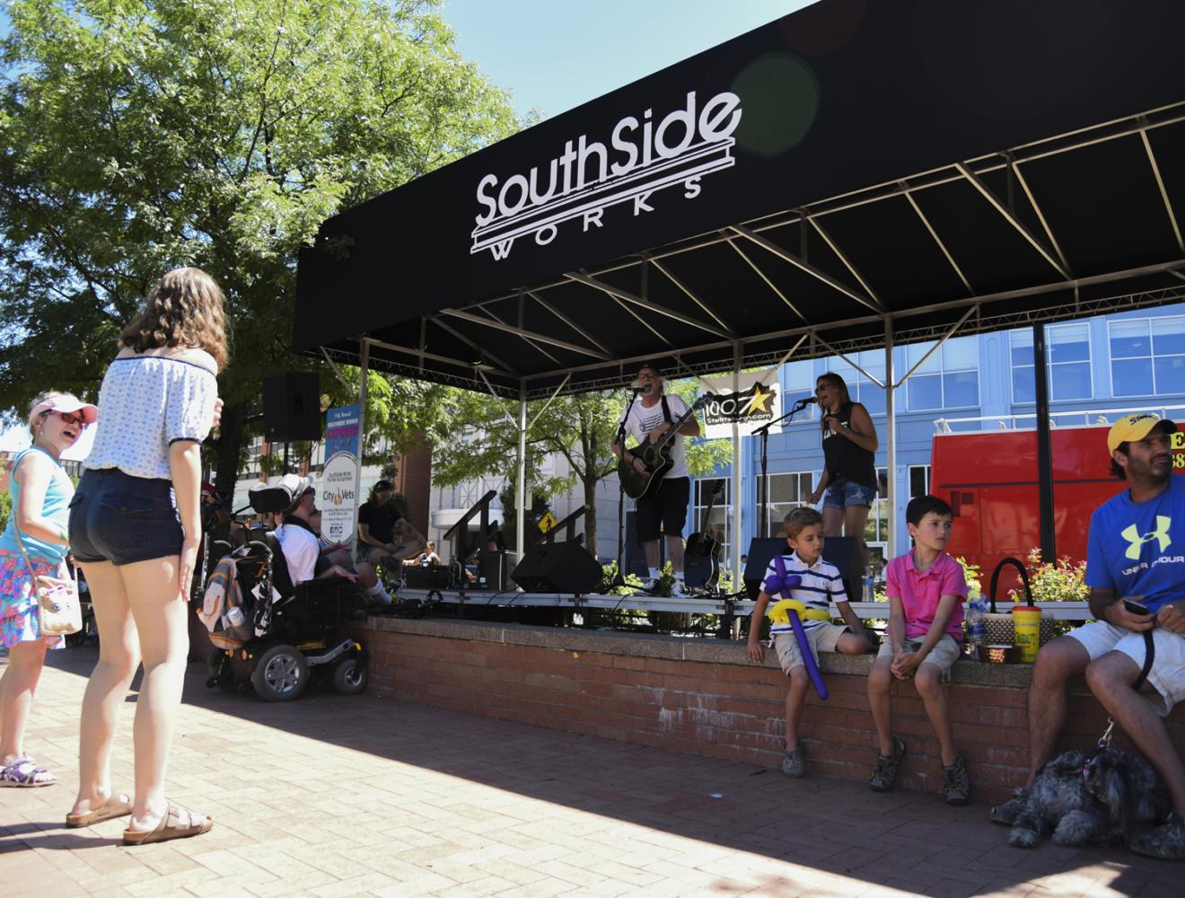 "Pittsburgh-based children's band Kelsey Friday & the Rest of the Week performed a variety of covers and original songs, including The Beatles' ""Blackbird,"" at SouthSide Works Exposed on Sunday afternoon. (Photo by Anna Bongardino 