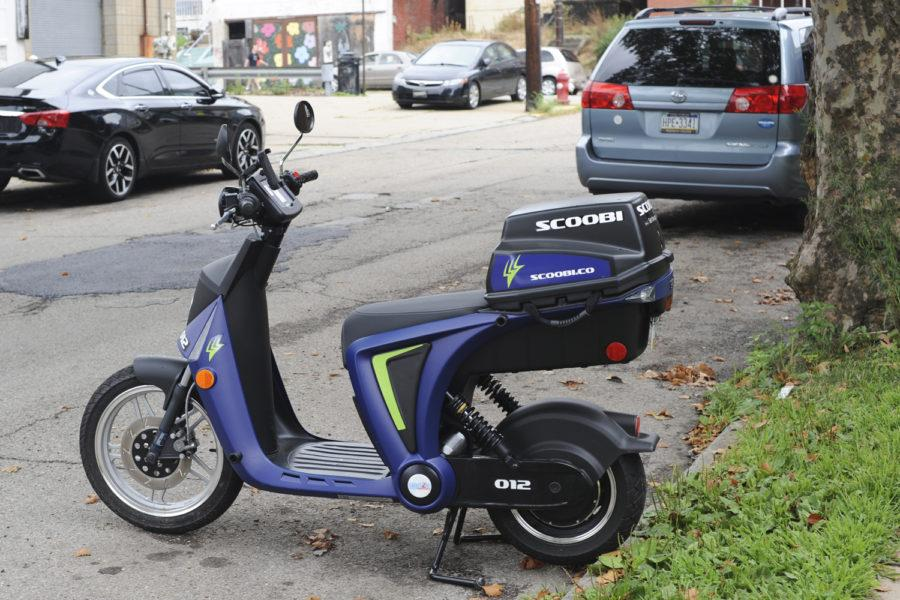One+of+100+Scoobi+electric+scooters+placed+around+Pittsburgh+July+21+sits+on+Penn+and+Roup+avenues+in+Friendship.+Anyone+18+and+older+with+a+valid+driver%E2%80%99s+license+can+rent+the+electric+scooters+using+a+smartphone.+%28Photo+by+Anne+Amundson+%7C+Staff+Photographer%29