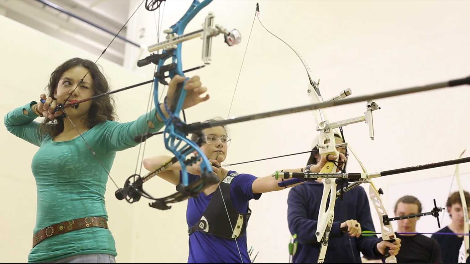 Kira Zack (left) practices with Pitt's archery team during the 2017-18 school year. (Photo by Chris Preksta courtesy of Julia Lam)