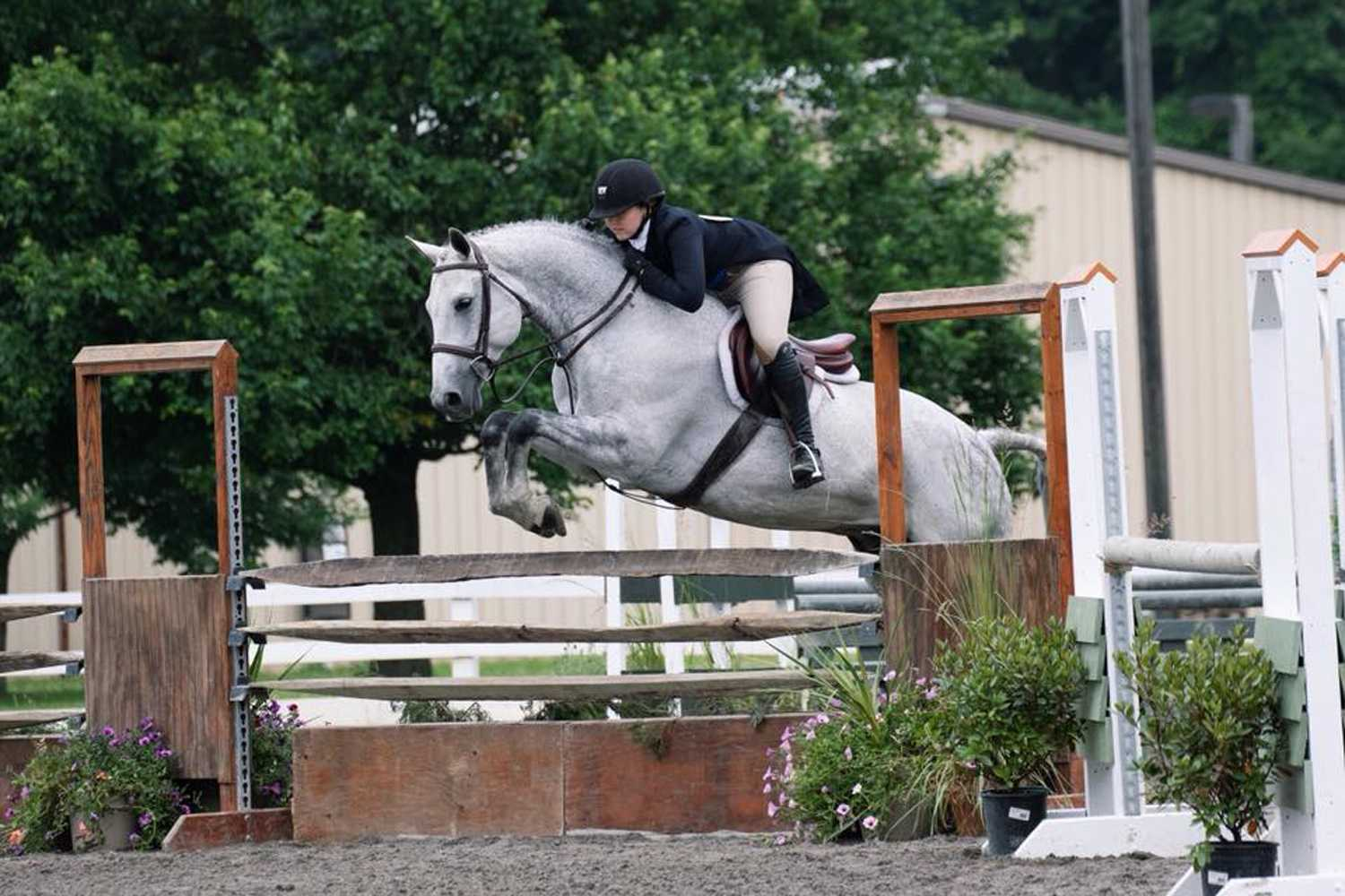 Sophomore biology major Haley Maher competes at State College with her horse Perry.