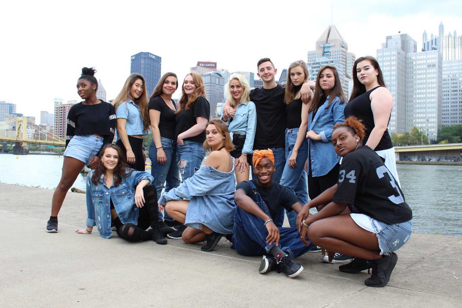 The hip-hop ensemble Controlled Chaos poses in black and denim outfits for a photoshoot. The group currently has 10 full-time members. (Photo courtesy of Mia Krawczel)