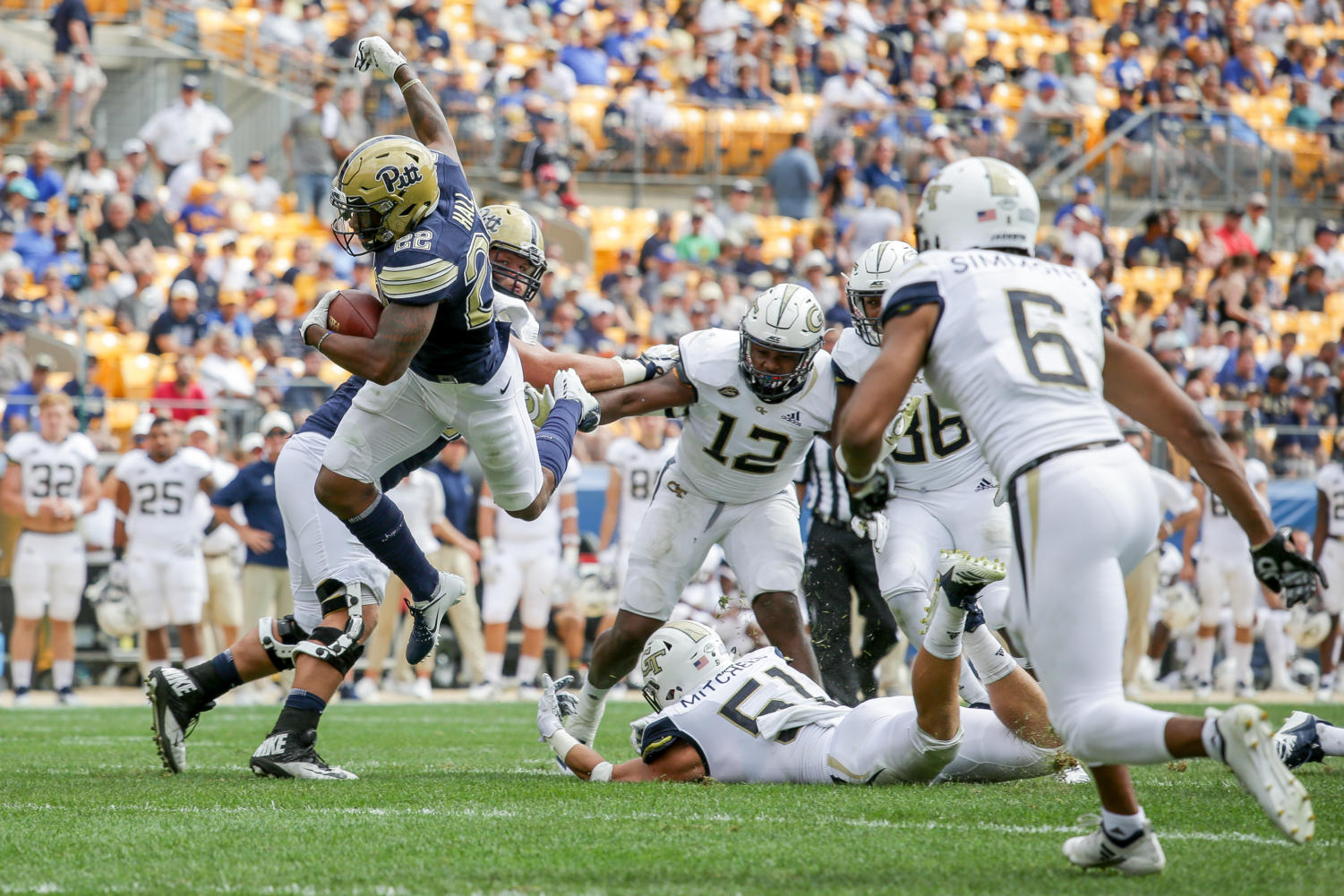 Senior running back Darrin Hall (22) leaps over Georgia Tech senior linebacker Brant Mitchell (51) while carrying the ball. The Panthers have lost two straight games since that win.