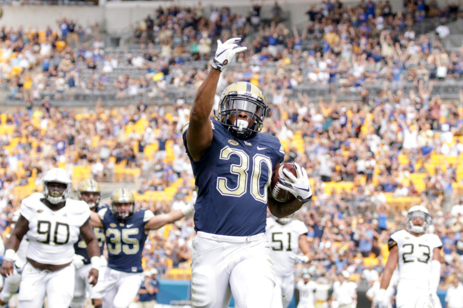 Redshirt+senior+running+back+Qadree+Ollison+%2830%29+celebrates+after+running+for+Pitt%27s+first+touchdown+against+Georgia+Tech.+