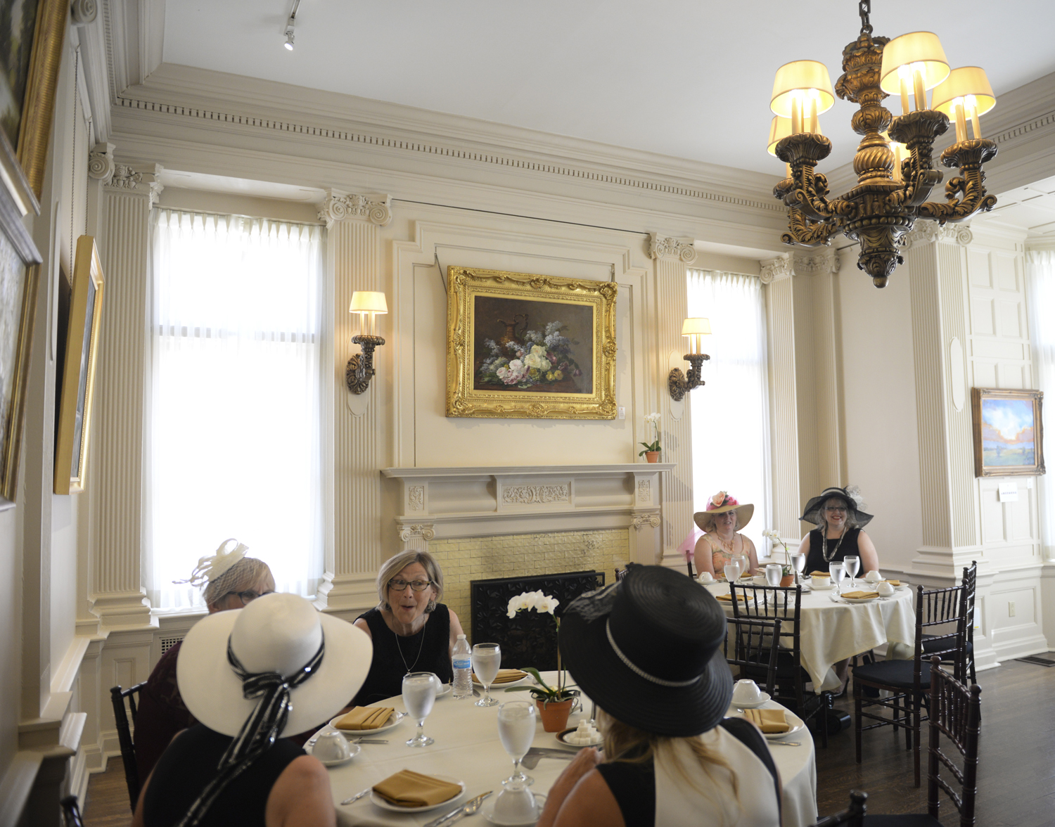 Women gathered at the Mansions on Fifth Hotel on Wednesday to celebrate the women of World War I with afternoon tea.