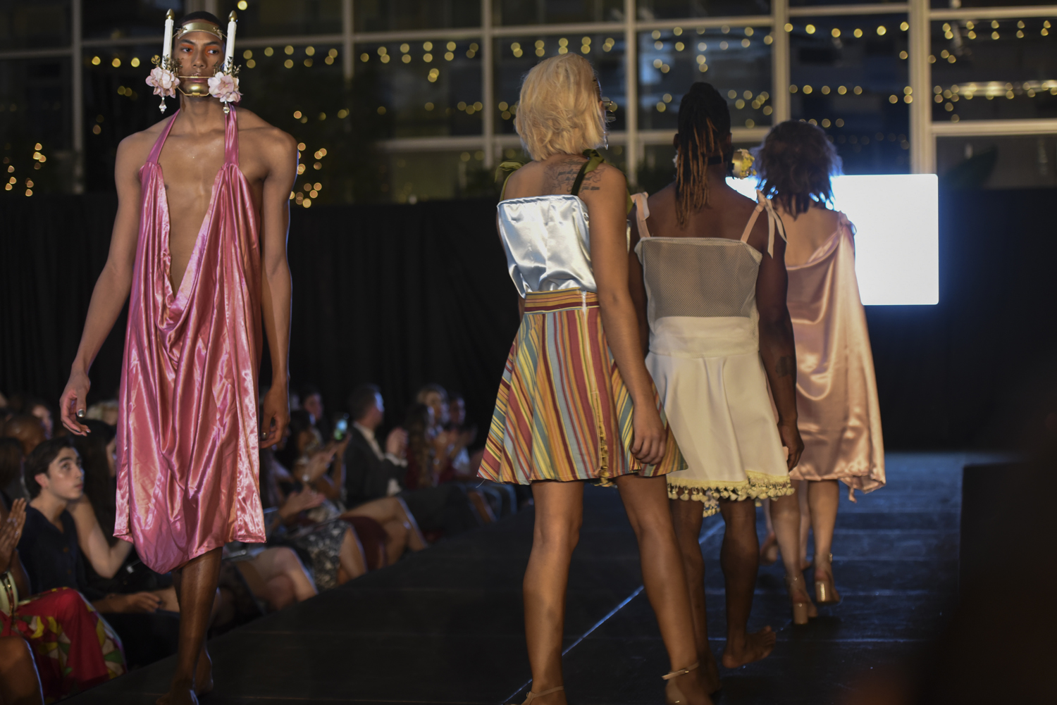 Models walk the runway in designs by Bernice Yu during Pittsburgh Fashion Week's Thursday night runway event at Wintergarden at PPG Place.