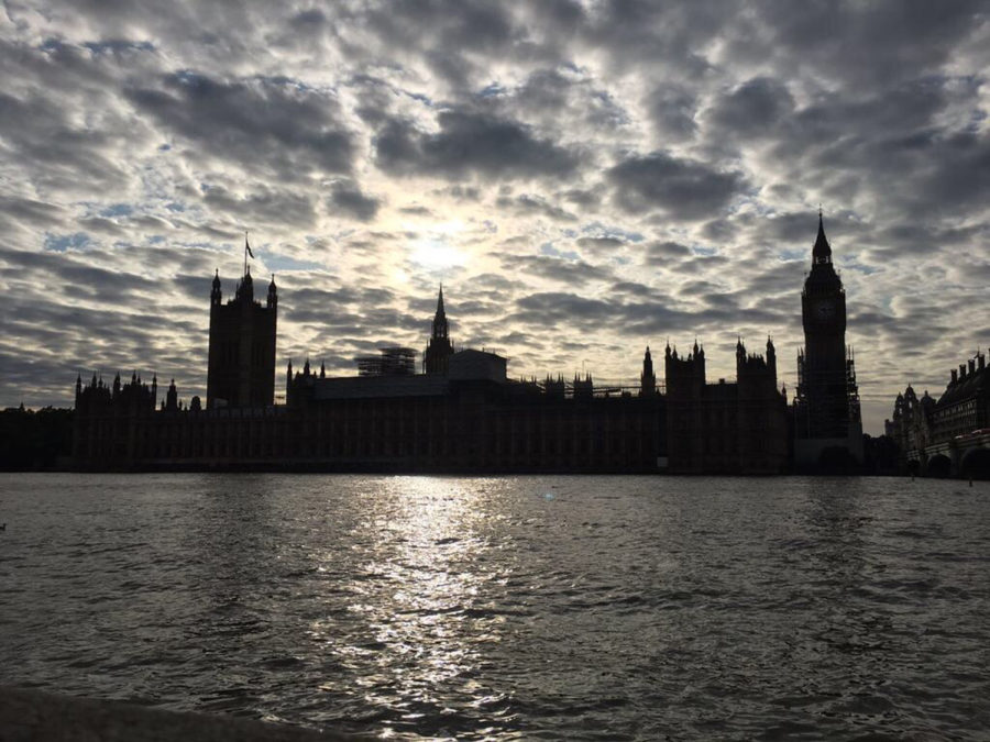 The+London+skyline+appears+backlit+on+a+cloudy+day.