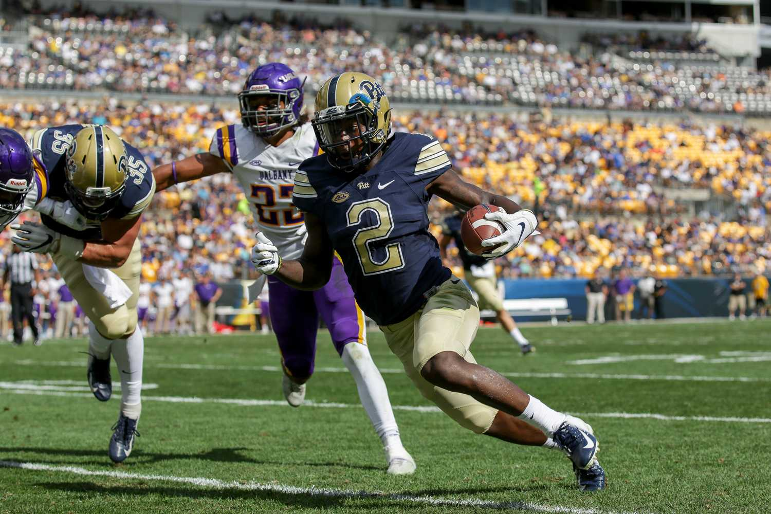 Junior wide receiver Maurice Ffrench runs the ball while completing his first touchdown against Albany.
