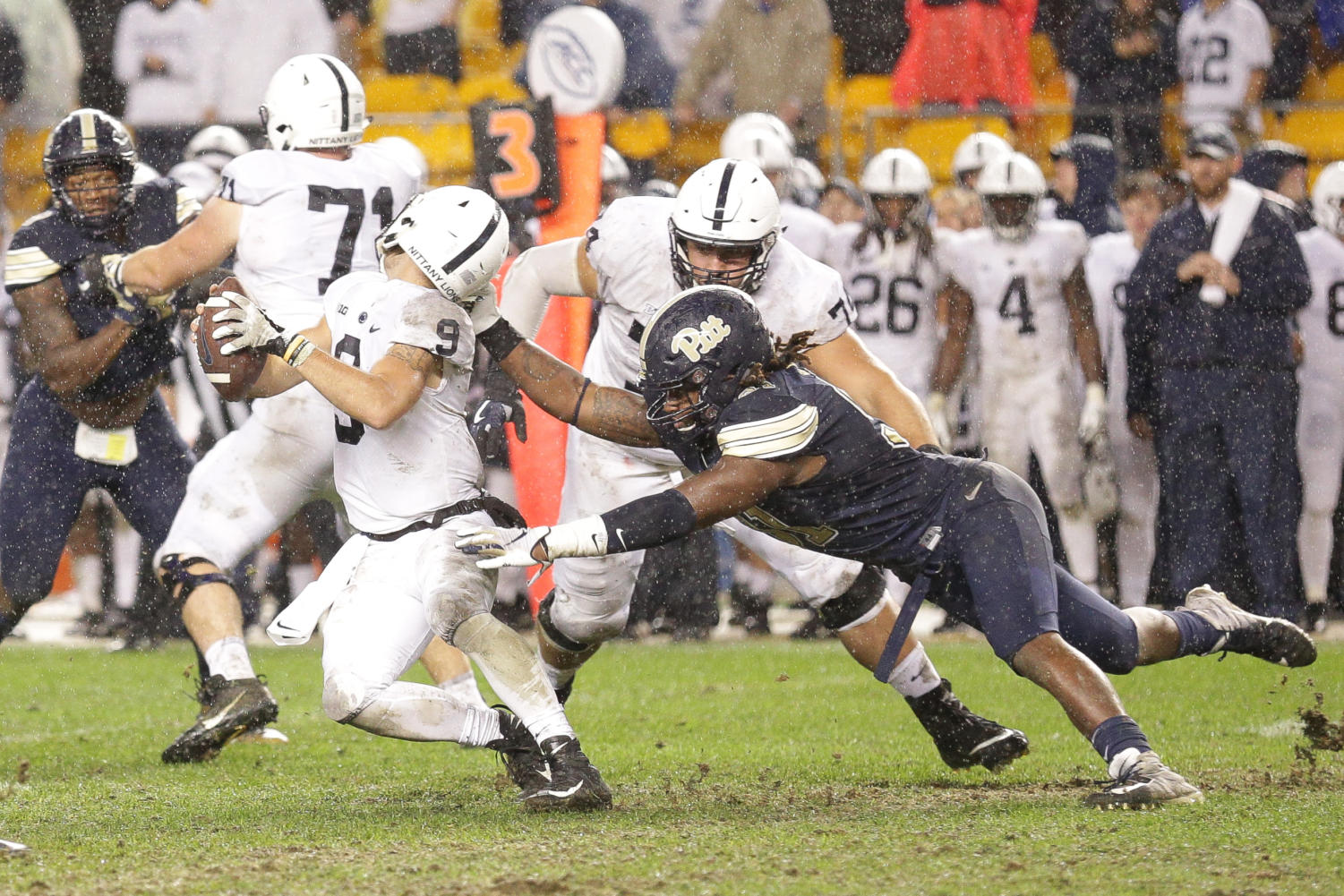 Redshirt sophomore defensive lineman Patrick Jones II (91) makes an illegal face-mask grab while attempting to sack Penn State senior quarterback Trace McSorley (9).