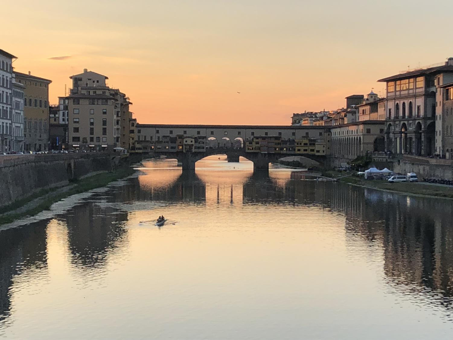 Ponte Vecchio, or the Old Bridge, arches across the Arno river in Florence.