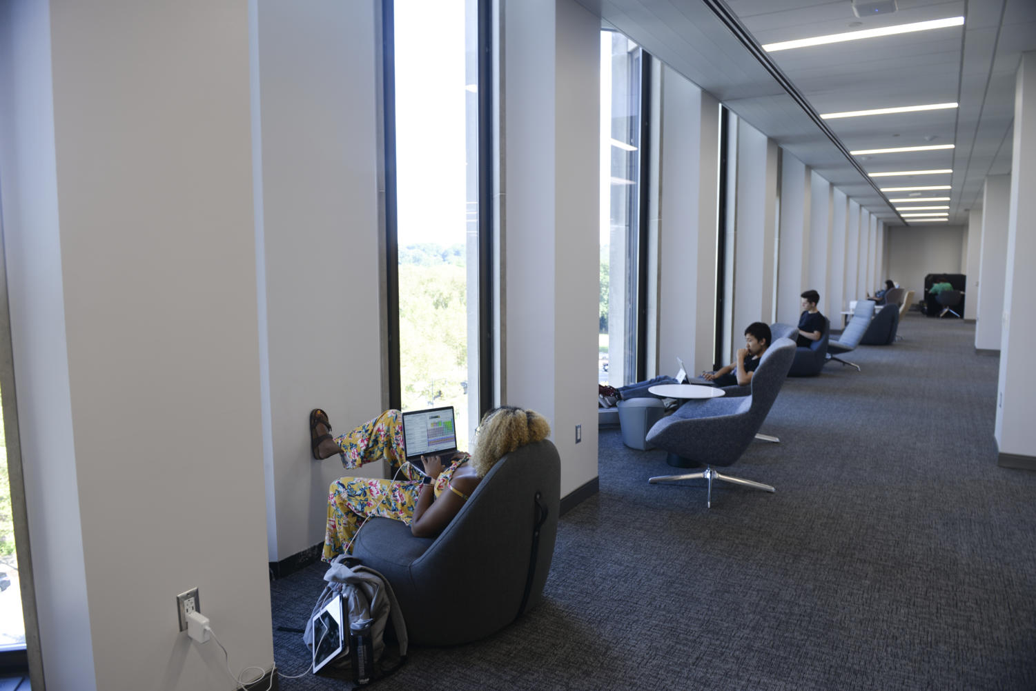 Students study in the renovated fourth floor of Hillman Library.