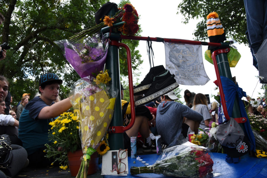 A small memorial to Mac Miller sits upon a slide at Blue Slide Park. (Photo by Knox Coulter   Staff Photographer)
