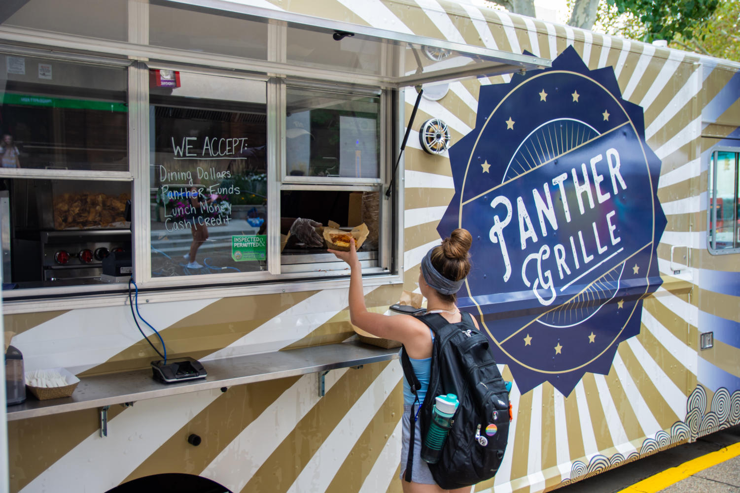 The Panther Grille food truck, seen here parked outside the William Pitt Union, can be found at various locations throughout lower campus. (Photo by Bader Abdulmajeed | Staff Photographer)