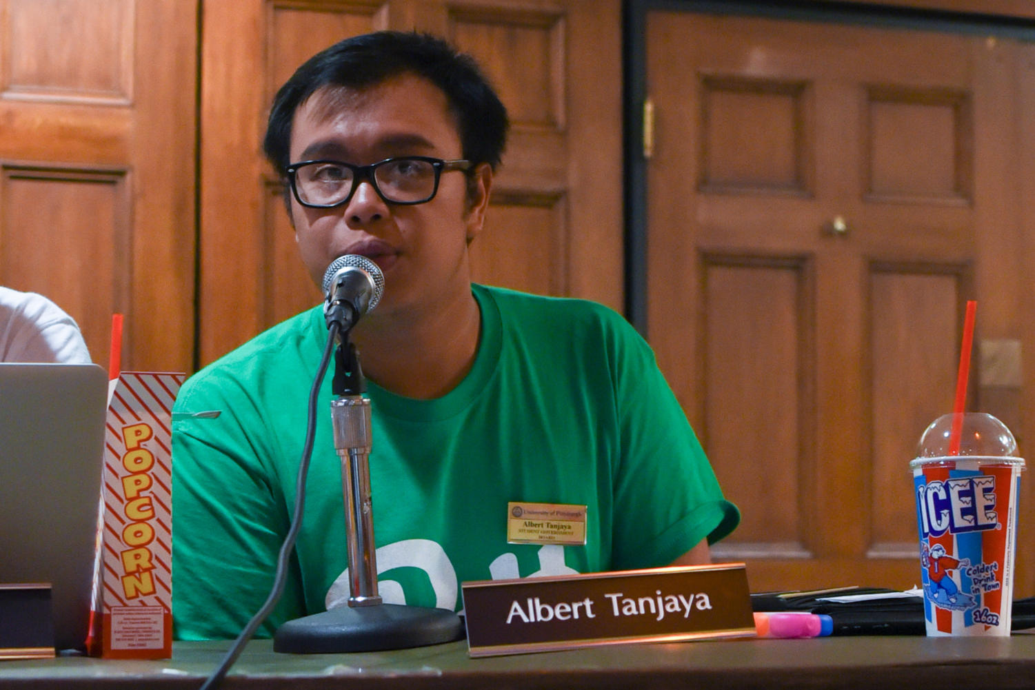 SGB Board member Albert Tanjaya discusses Hillman Library's hot-food policy at Tuesday night's public meeting. (Photo by Knox Coulter | Staff Photographer)