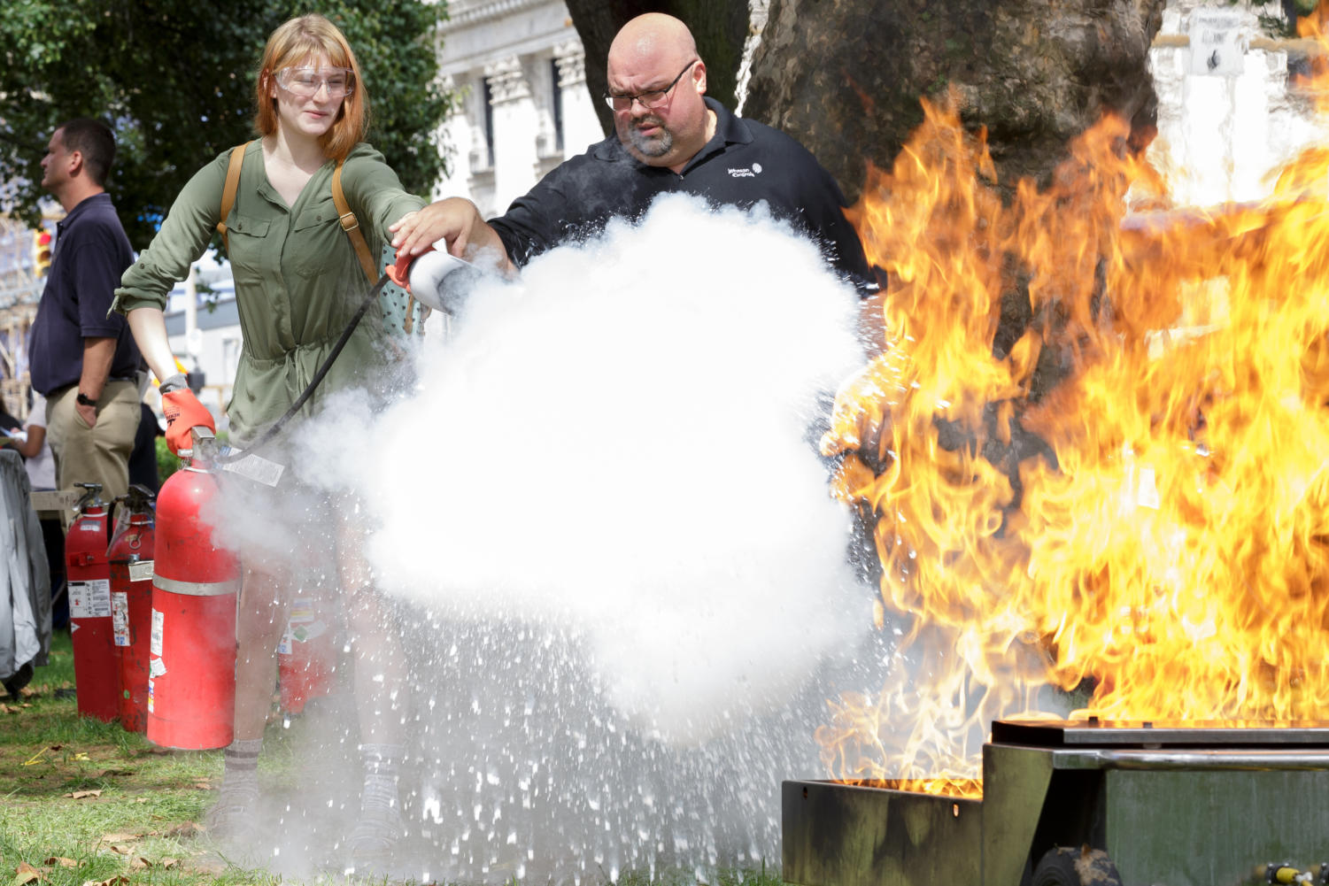 Pitt's Department of Environmental Health and Safety demonstrates proper fire extinguisher handling at SGB's Fall Safety Fair Tuesday afternoon. (Photo by Anas Dighriri | Staff Photographer)