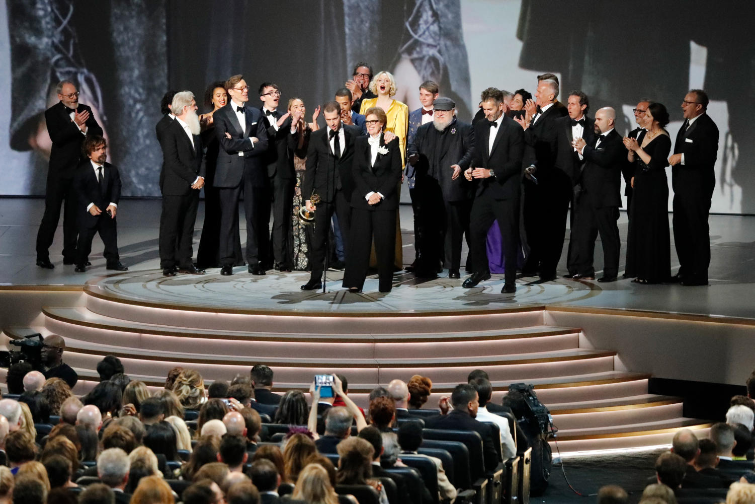"The cast and crew of ""Game of Thrones"" accepting the Outstanding Drama Series award during the 70th Primetime Emmy Awards at the Microsoft Theater in Los Angeles on Monday. (Brian van der Brug/Los Angeles Times/TNS)"