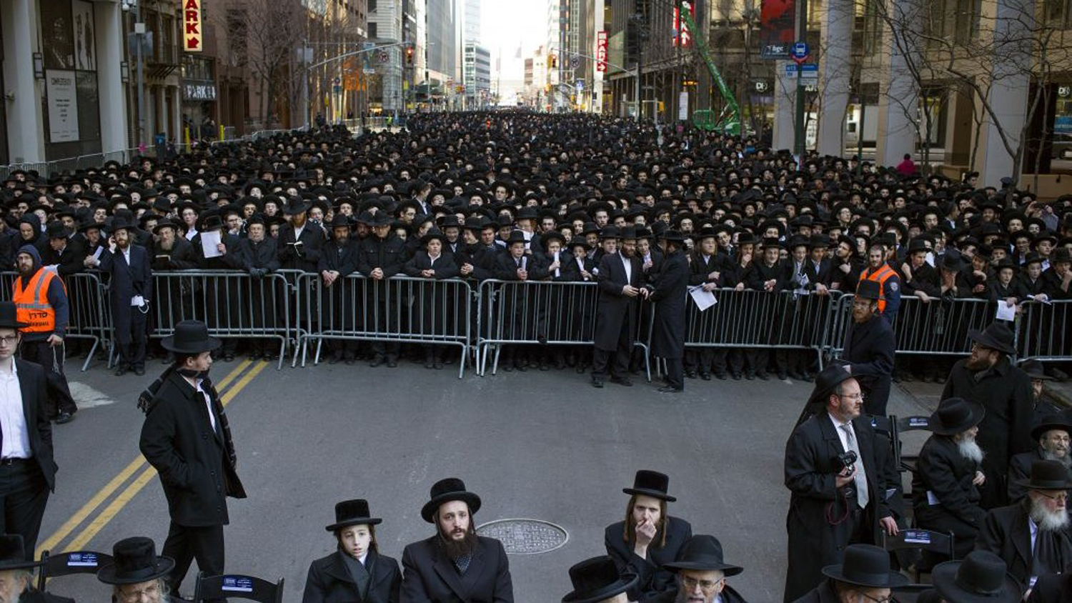A group of Haredi Jewish people hold a demonstration on Wall Street in opposition to the Israeli draft law in 2014.