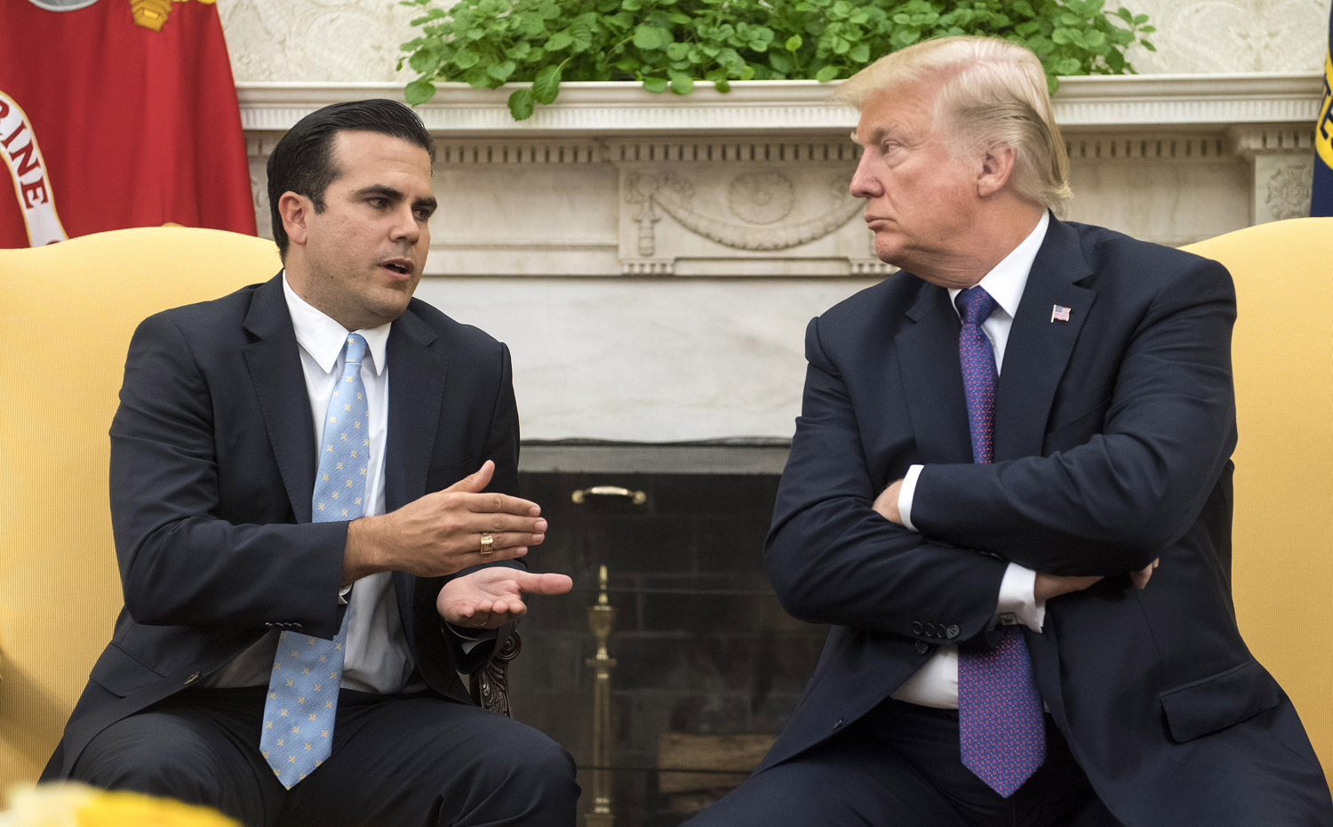 President Donald Trump listens as Puerto Rico Gov. Ricardo Rossello speaks during a meeting in the Oval Office at the White House Oct. 19, 2017.