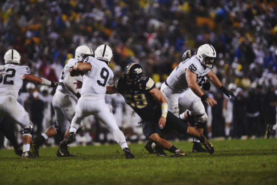 Senior+captain+Quintin+Wirginis+%2858%29+lunges+for+Penn+State+quarterback+Trace+McSorley+%289%29.+