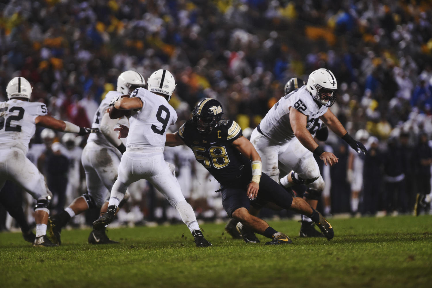 Senior captain Quintin Wirginis (58) lunges for Penn State quarterback Trace McSorley (9).