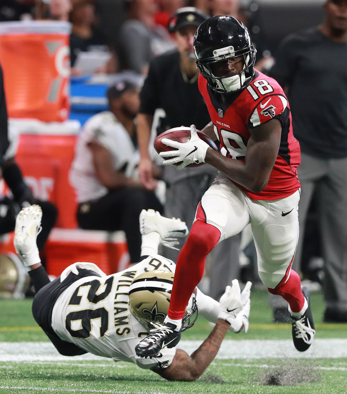 Atlanta Falcons wide receiver Calvin Ridley catches his second touchdown pass of the day past New Orleans Saints defender P.J. Williams during the second quarter on Sunday in Atlanta, GA.