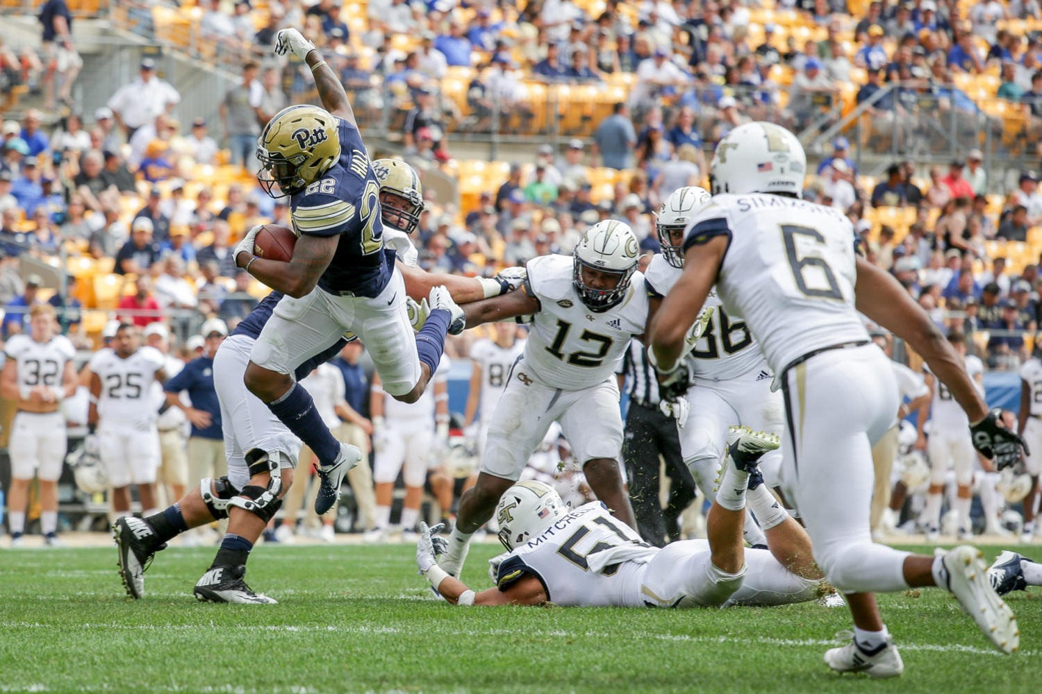 Senior running back Darrin Hall (22), pictured here against Georgia Tech, led Pitt with 84 rushing yards in their loss to North Carolina.