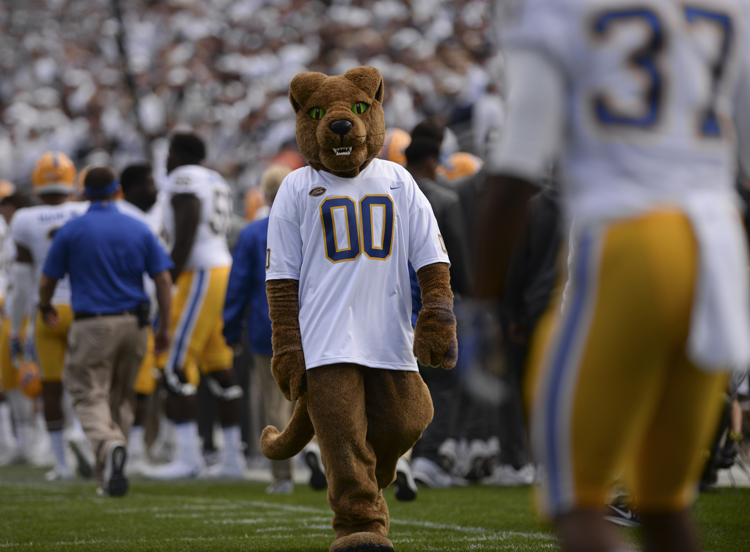 Roc, the Panthers' mascot, walks toward Qadree Ollison during last year's Pitt vs. Penn State game in State College. (Photo by Anna Bongardino | Visual Editor)