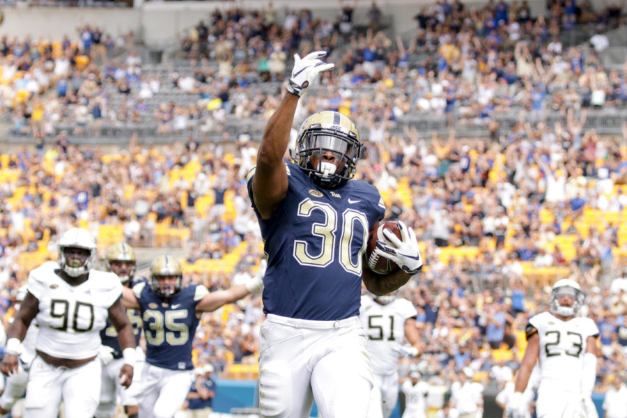 Redshirt senior running back Qadree Ollison (30) celebrates after running for Pitt's first touchdown against Georgia Tech Sept. 15.