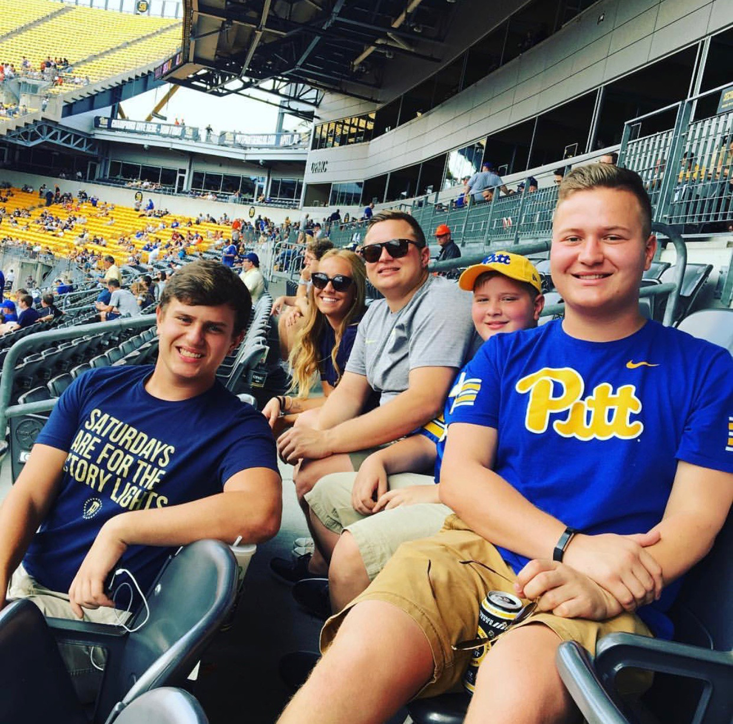 (From left to right) Pierce, Joel's girlfriend Kati Fischer, Joel, Reese and Gavin Yahner sit in the stands at Heinz Field.