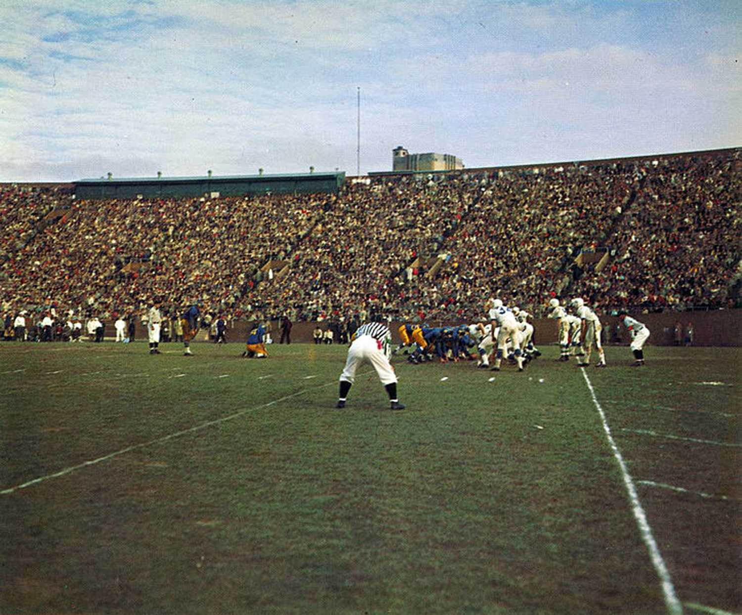 The Pitt and Penn State football teams face off in Pitt Stadium on November 27, 1958. (Image via Wikimedia Commons)