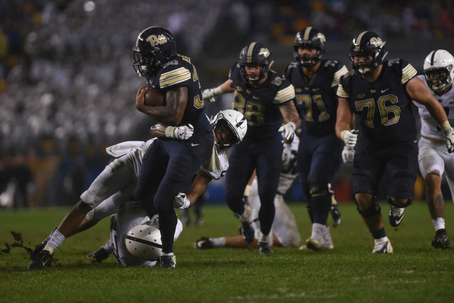 Redshirt senior running back Qadree Ollison (30) completed Pitt's only successful touchdown at the Panther's 51-6 loss to Penn State Saturday evening. (Photo by Anna Bongardino | Visual Editor)