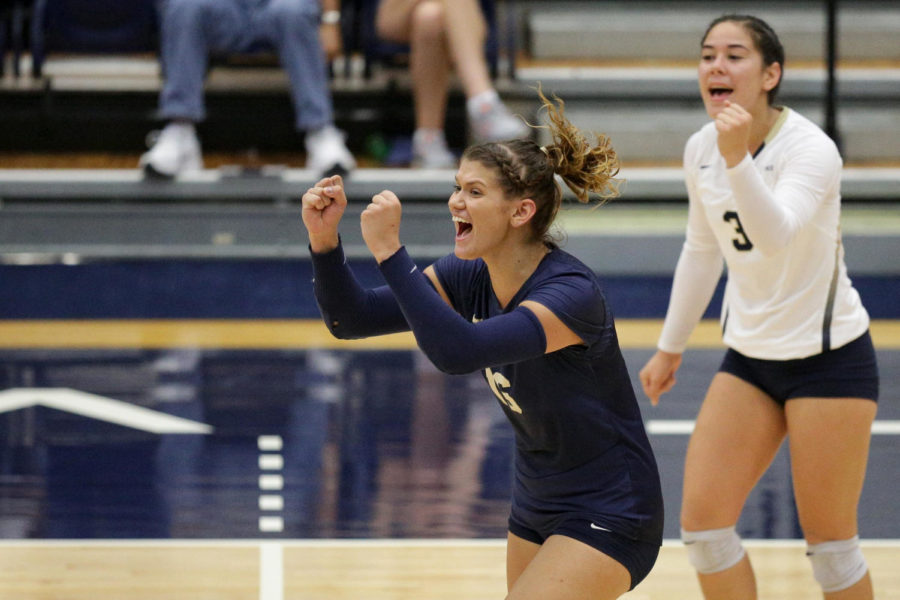 Senior Kamalani Akeo (3) and redshirt senior Angela Seman (16) celebrate during the third set. (Photo by Thomas Yang | Assistant Visual Editor)