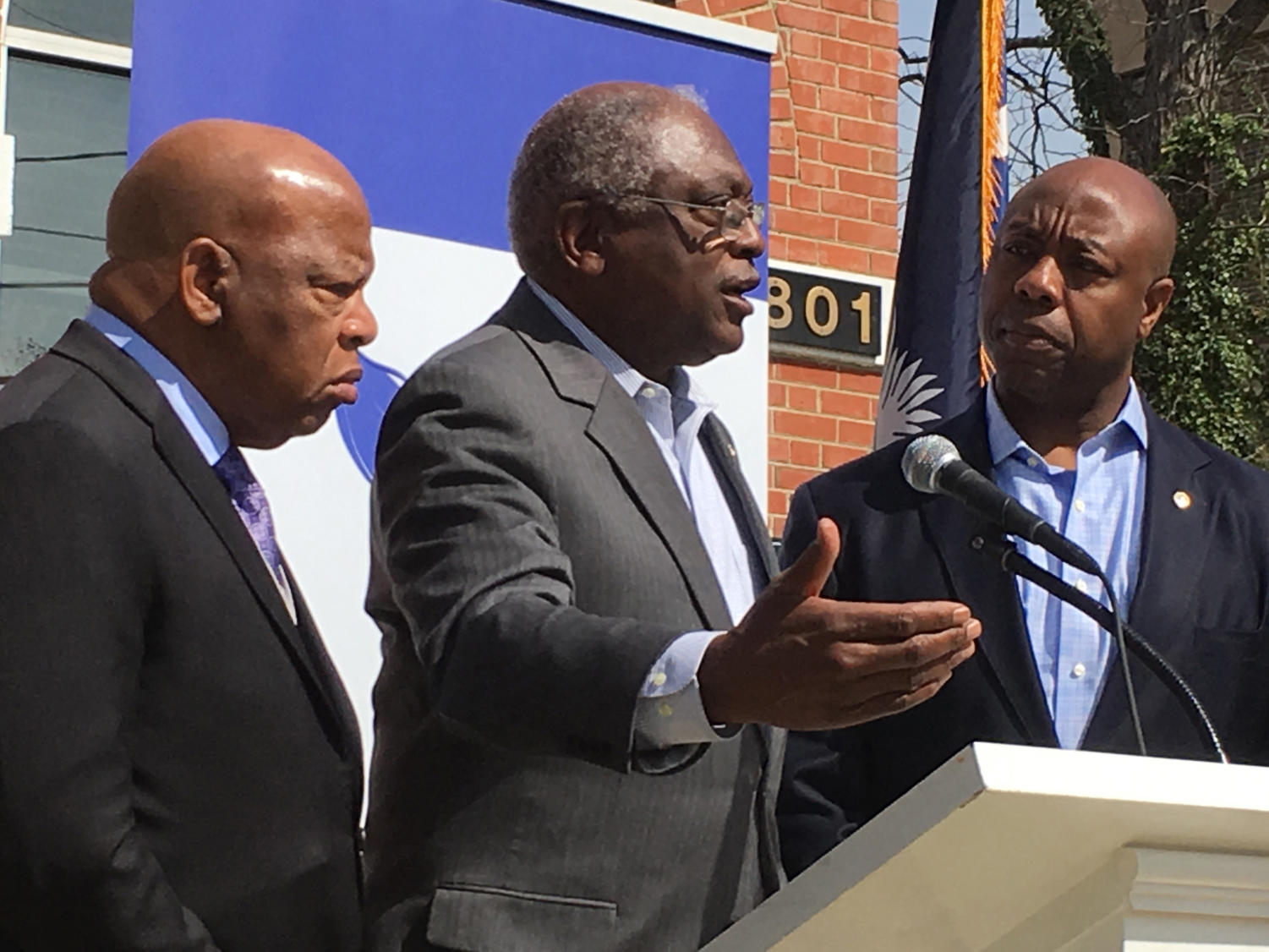 U.S. Reps. John Lewis (D-Ga.), Jim Clyburn, (D-S.C.), and U.S. Sen. Tim Scott, (R-S.C.), speak to reporters kicking off the Faith and Politics Institute civil-rights pilgrimage in South Carolina on March 18, 2016, in Columbia, S.C. (Jamie Self/The State/TNS)