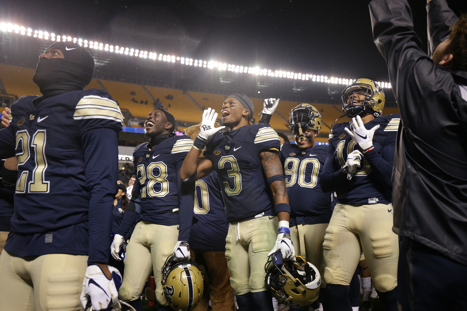 The Pitt football team pictured celebrating after beating Duke in October. They're celebrating again after winning the ACC's Coastal division.