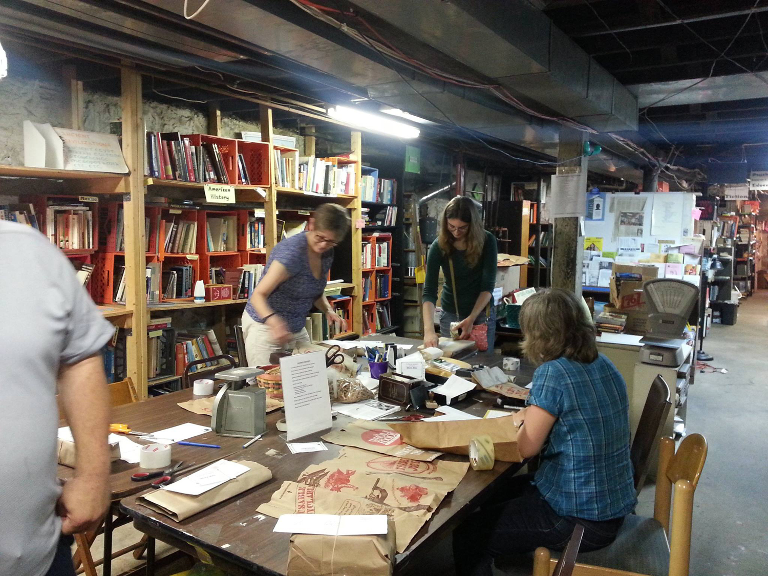 Volunteers at Book 'Em — a volunteer project run by the Thomas Merton Center — package books to send to prisoners in Pennsylvania on the first three Sundays of every month.
