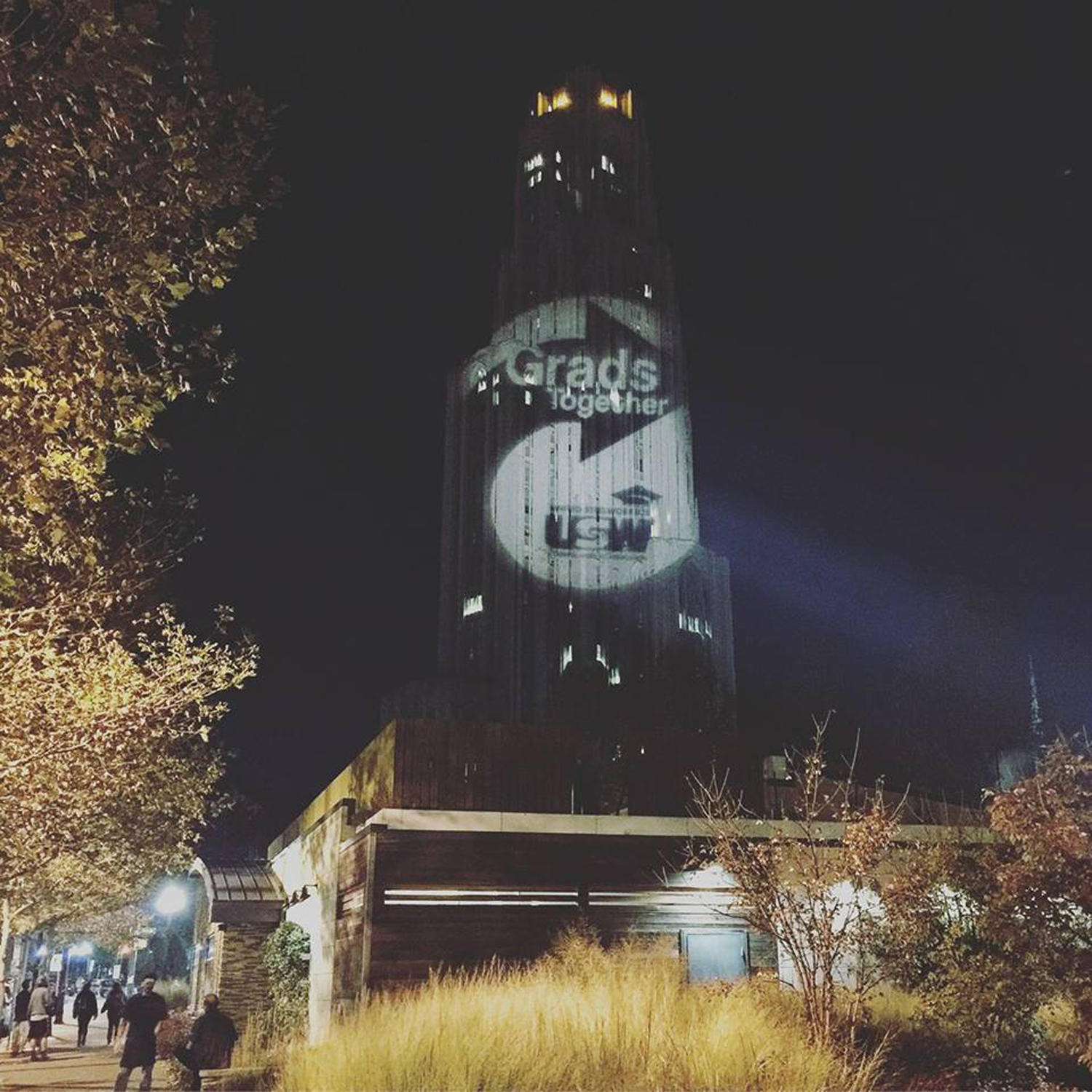 Pitt grad student union organizers, in conjunction with United Steelworkers, projected their campaign logo on the Cathedral last year.