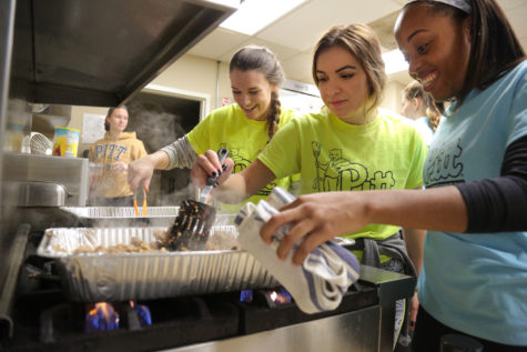 Rachel Feil, Ashley Ward-Willis and Sydney Massenberg (left to right) cook chili for the 46 people who attend the Circles program at the YWCA in Homewood. (Photo by Theo Schwarz | Senior Staff Photographer)