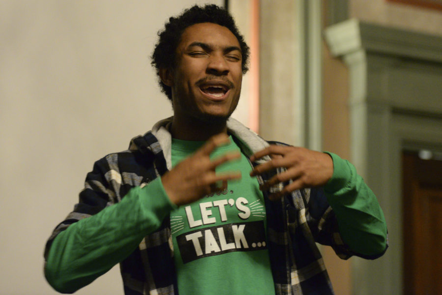Senior civil environmental engineering major Isaiah Spencer-Williams performs his poem