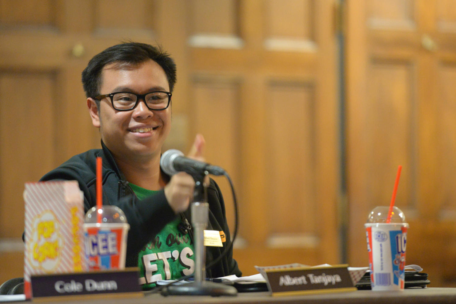 """Board member Albert Tanjaya gives the Pitt Club Rock Climbing team representative a thumbs-up, saying """"have a real Philly cheesesteak for me"""" after the team's funding request to compete in Philadelphia is approved. (Photo by Theo Schwarz    Senior Staff Photographer)"""
