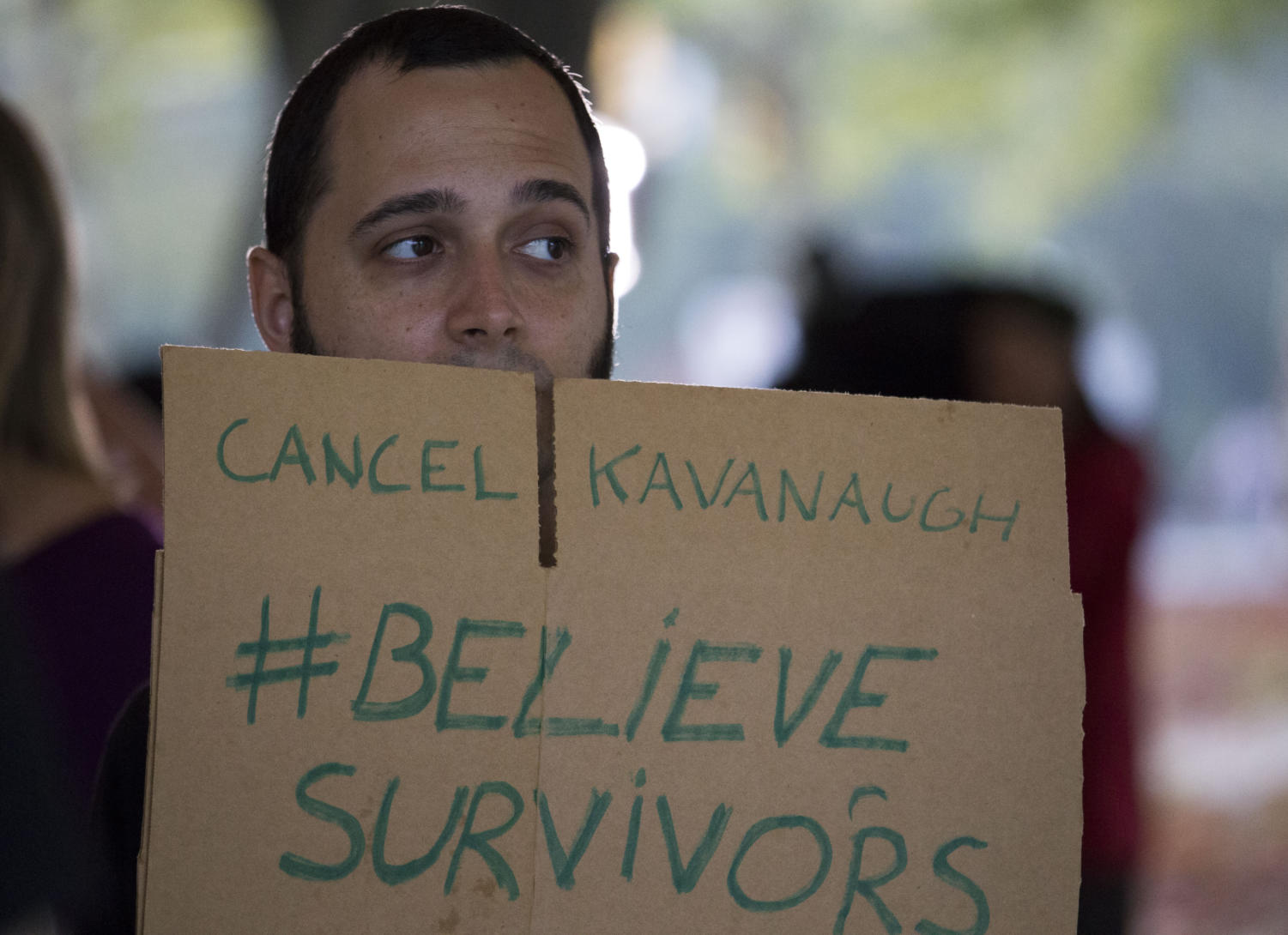 "One of more than 75 protesters who gathered in Schenley Plaza Thursday afternoon holds a sign that reads ""Cancel Kavanaugh #BelieveSurvivors."""