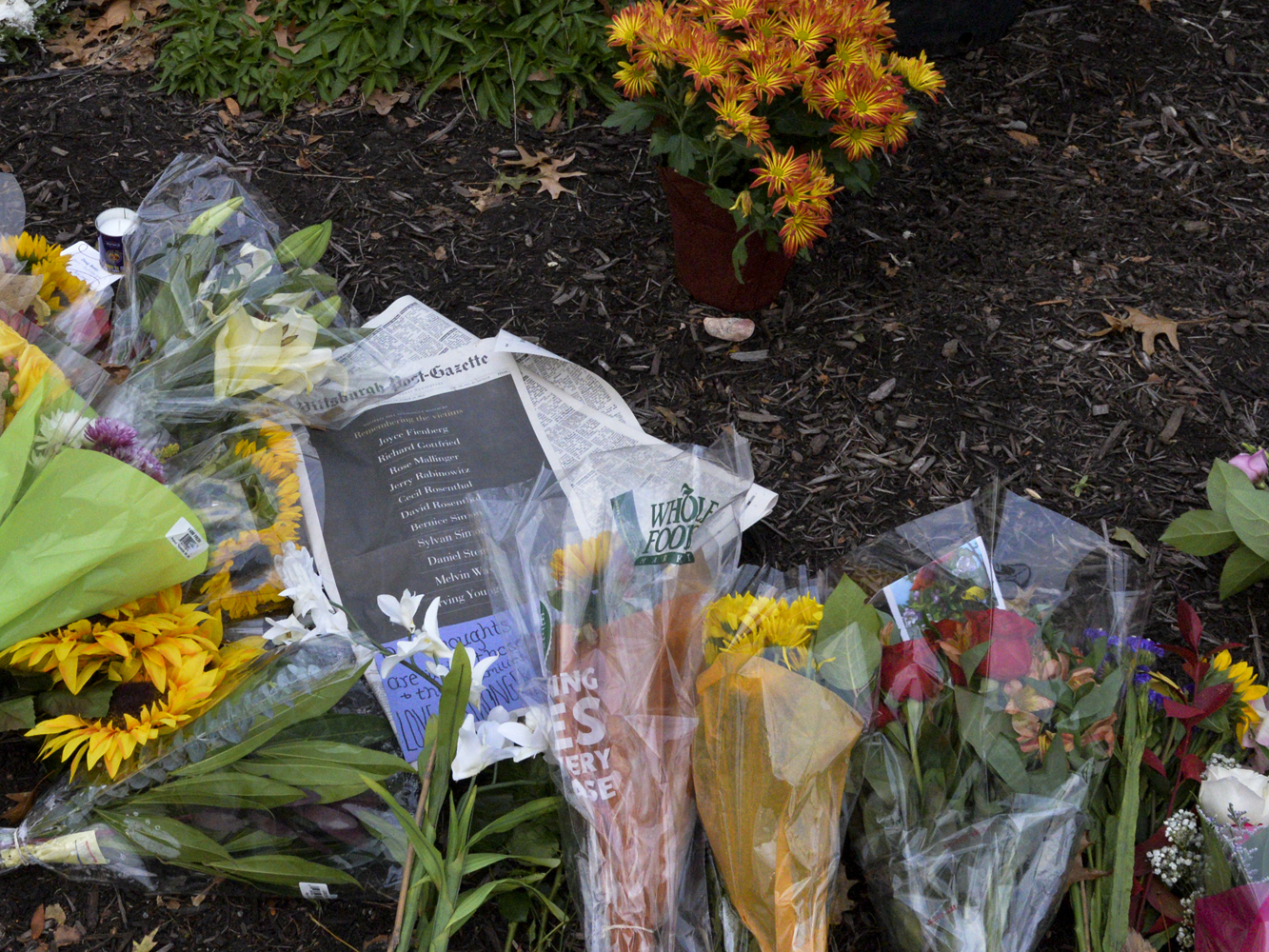 Mourners placed flowers, notes and the front page of the Pittsburgh Post-Gazette, which lists each victim's name outside Tree of Life Synagogue.