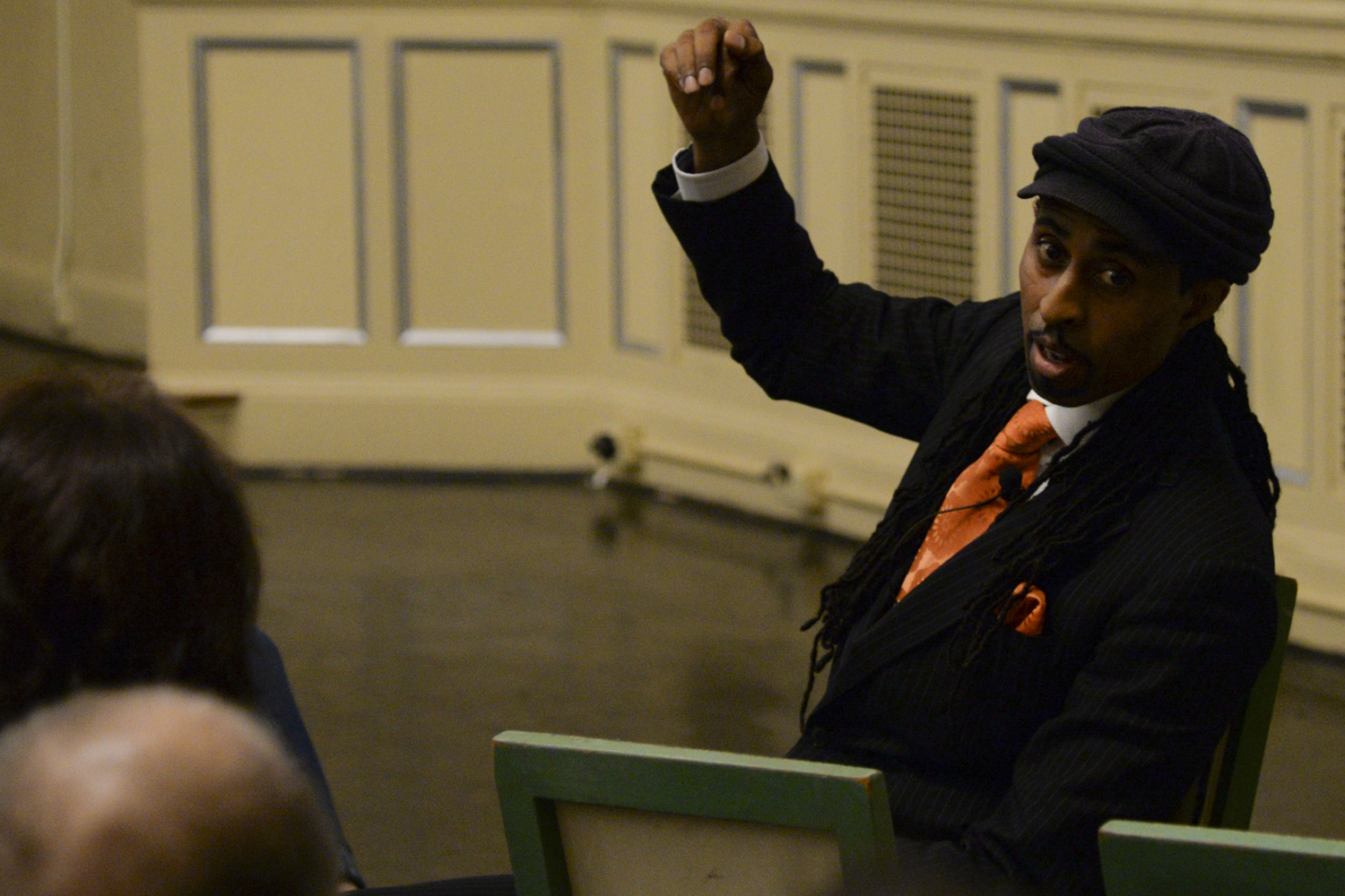 Former EPA employee Mustafa Santiago Ali sat in the audience at the Twentieth Century Club as he spoke about climate injustice Wednesday.