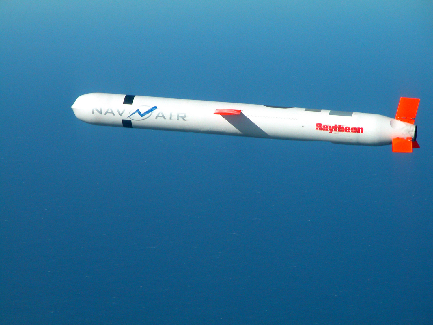A Tomahawk cruise missile from a 2002 test firing off the coast of California. (Image via Wikimedia Commons)