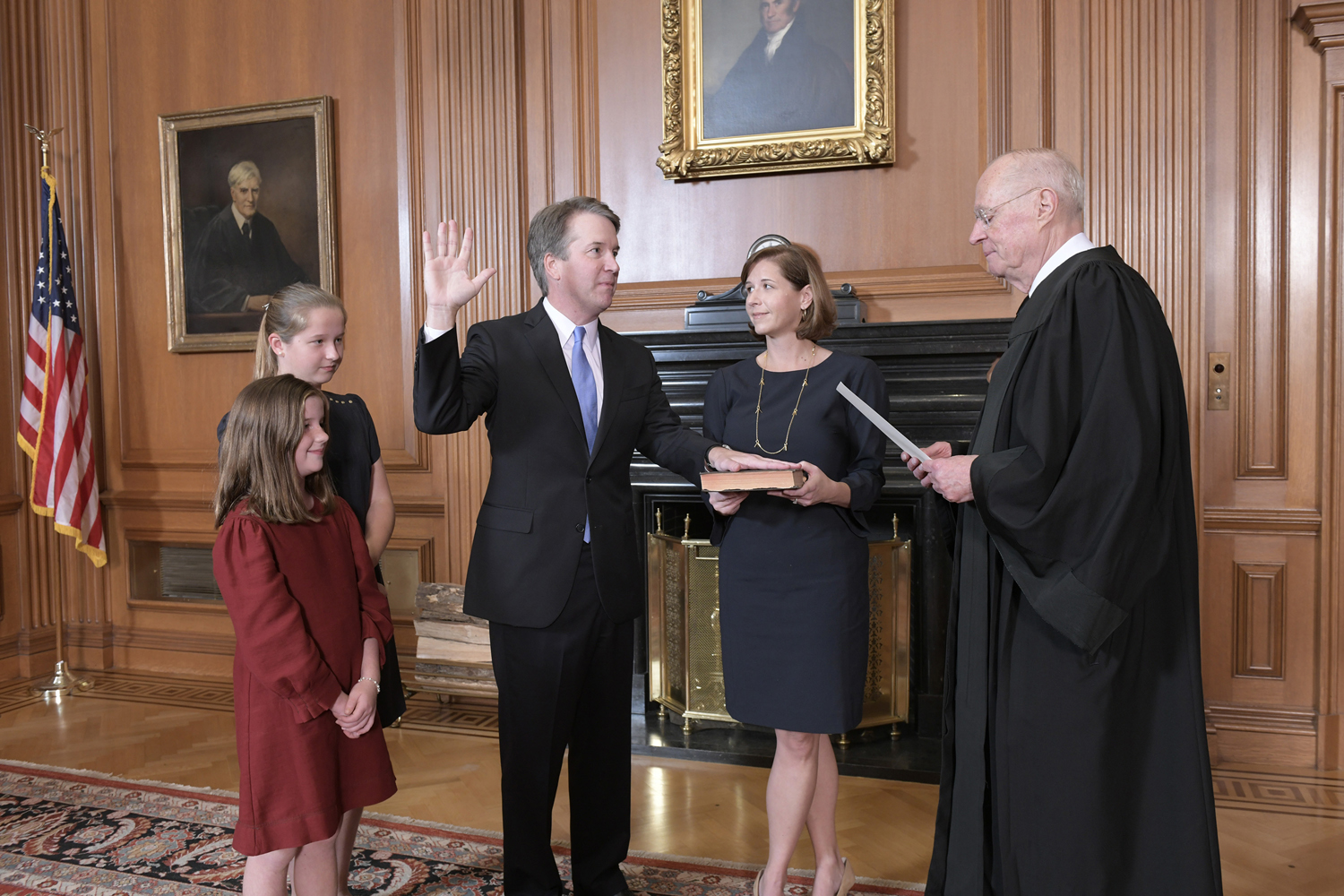 Retired Justice Anthony M. Kennedy, administers the Judicial Oath to Judge Brett M. Kavanaugh in the Justices' Conference Room at the Supreme Court Building on Saturday in Washington, DC.