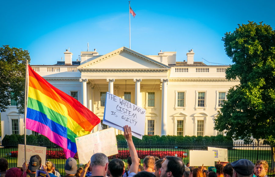 Protesters+gathered+in+front+of+the+White+House+after+Trump%E2%80%99s+proposed+military+ban+against+transgender+people+in+the+summer+of+2017.+
