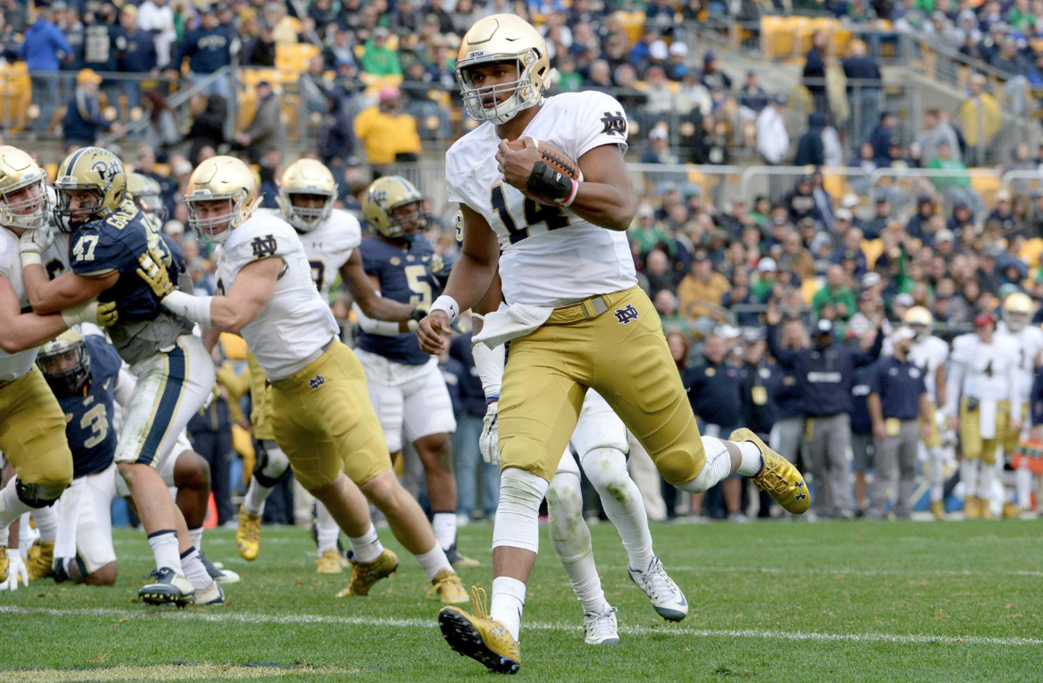 Then-quarterback for Notre Dame DeShone Kizer scores a touchdown on a 2-yard against Pitt in the fourth quarter at Heinz Field Nov. 7, 2015. Notre Dame won 42-30.