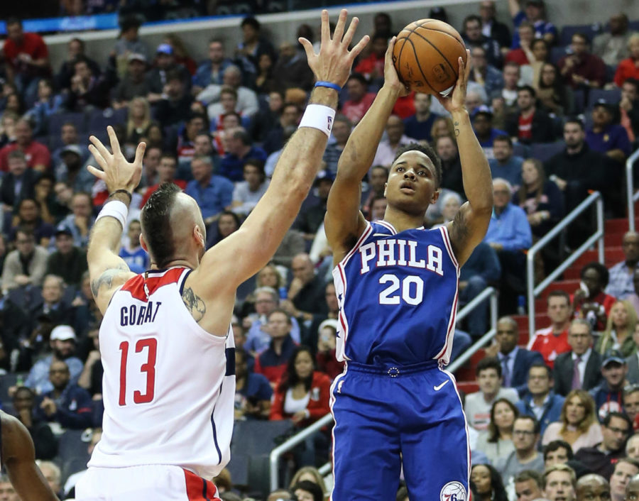 The+Philadelphia+76ers%E2%80%99+Markelle+Fultz+%2820%29+shoots+over+the+Washington+Wizards%E2%80%99+Marcin+Gortat+%2813%29+at+the+Capital+One+Arena+in+Washington%2C+D.C.%2C+on+October+18%2C+2017.+