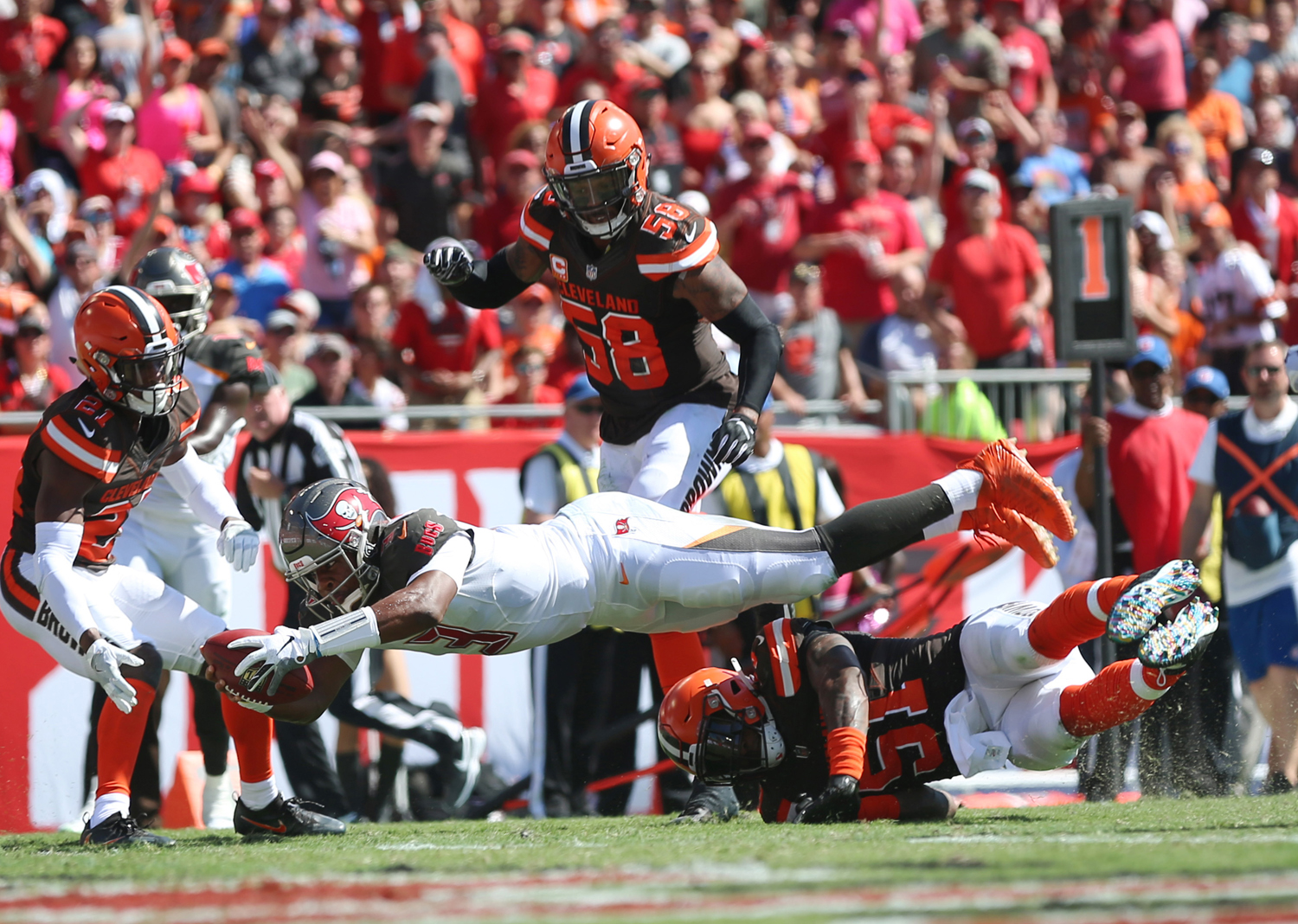 Tampa Bay Buccaneers quarterback Jameis Winston (3) dives for a touchdown over Cleveland Browns outside linebacker Jamie Collins (51) in the second quarter on Sunday in Tampa, Fla.