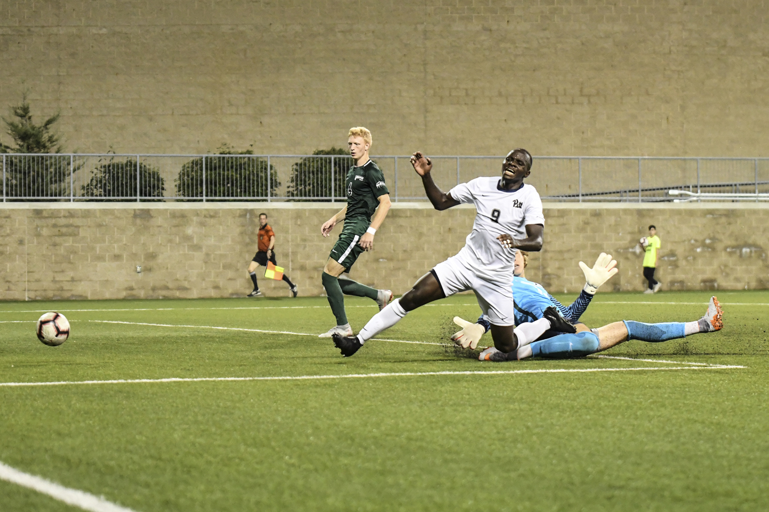 Sophomore forward Edward Kizza takes a shot on goal during Pitt's 3-4 loss to Cleveland State Monday night.