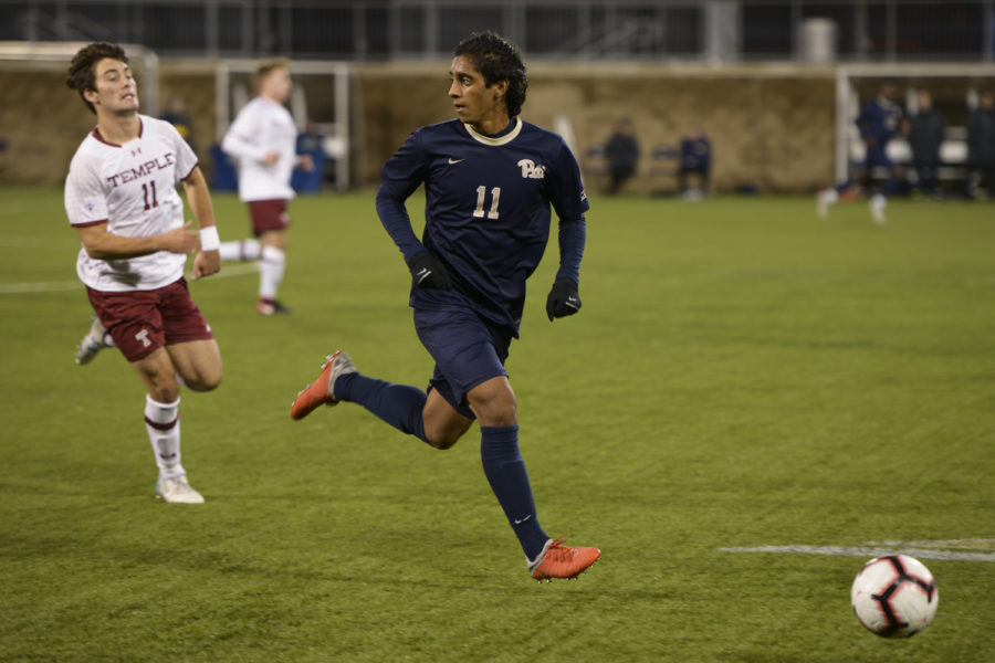 First-year midfielder Rodrigo Almeida winds up a pass during the Panthers' 3-2 victory over Temple Sunday night.
